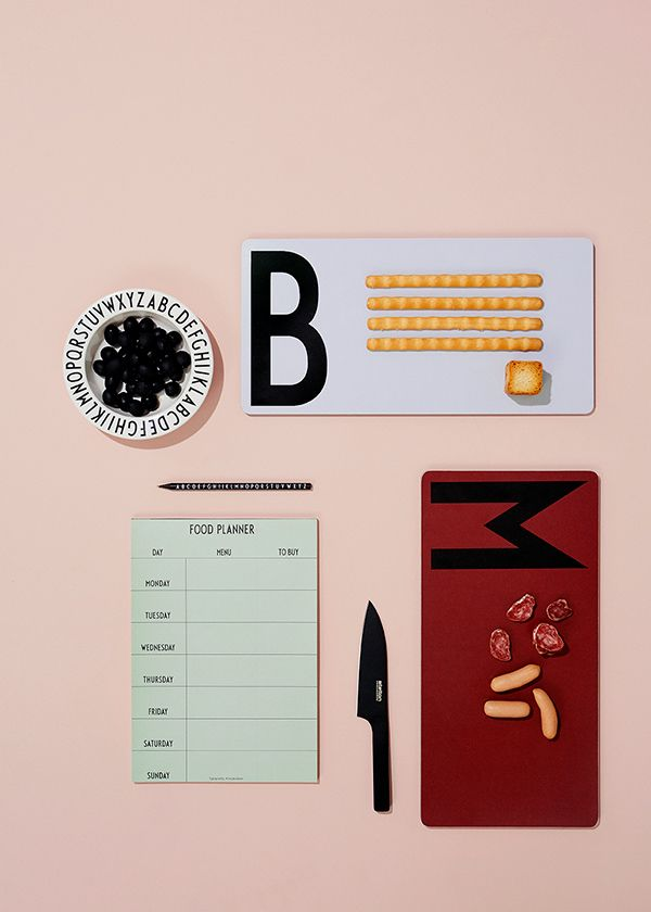 Cutting boards and weekly food planner with a cool graphic expressions.  The cutting boards have the letters 'M' for meat and 'B' for bread, to keep the ketchen nice and clean.