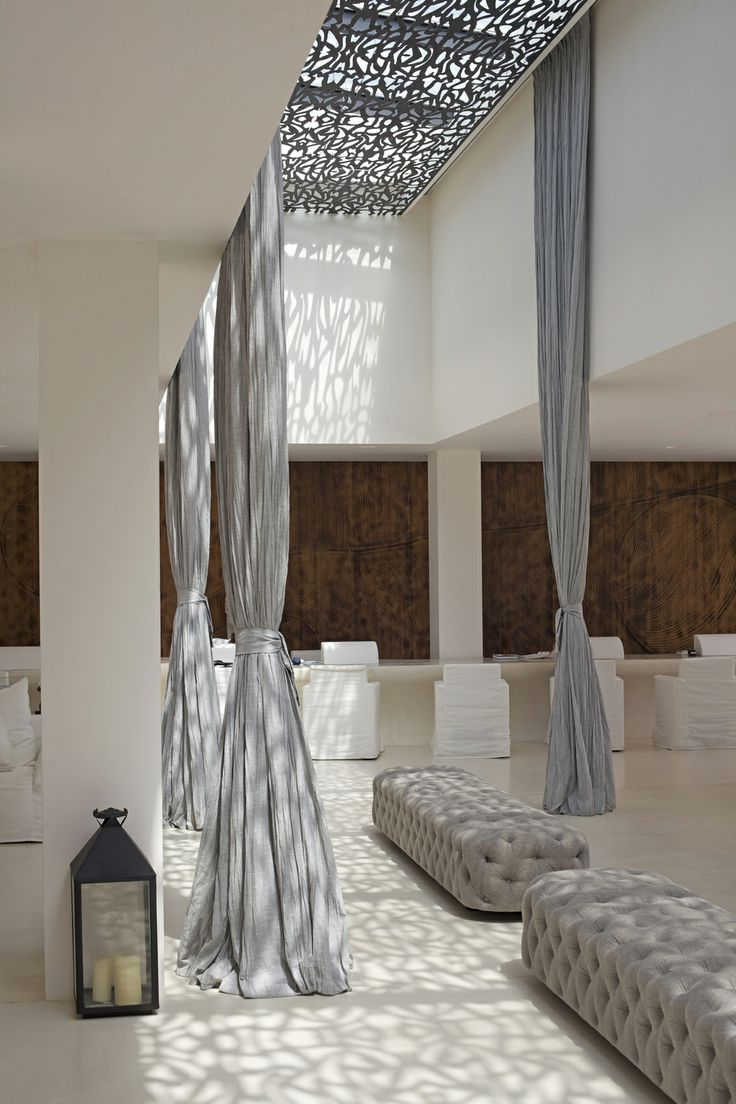 Reception & Concierge - Destino Ibiza - Destino Ibiza  The play with light is beautiful, casting pattern the plain surfaces and adding wonderful texture. The beauty of natural daylight controlled, achieved by understanding its  importance and use within interiors.