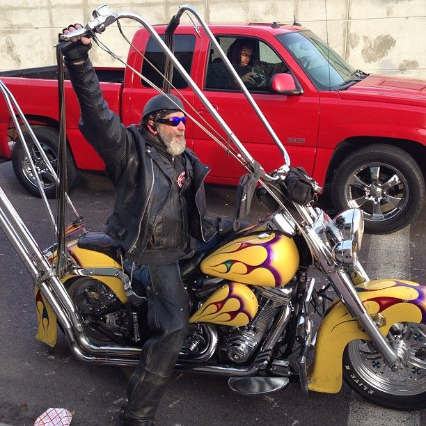 So that picture was real, and not Photoshopped. Bike is still around, guy's is a little older, and grayer.