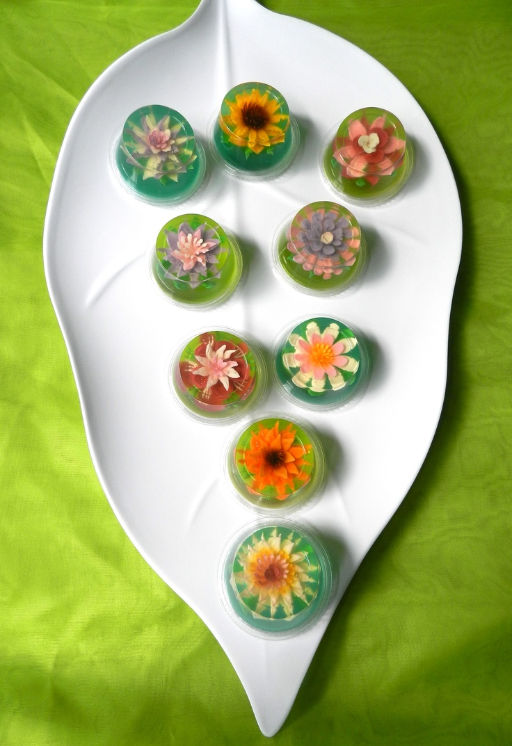 Our Fancy Flower Jelly Shots are  a whole lot more sophisticated  than regular jello shots, the designs are  made of exotic floral works of art by hand,  injecting gelatin into the mold  to make each petal, each stamen this art  work are edibles made from gelatin  These extravaganzas are Made with  gelatin, and a great variety of flavors and fruit juices.