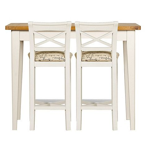 Our 'Wadebridge' range combines solid oak and soft white painted acacia wood for a contemporary take on the classic country farmhouse look. This breakfast bar features a tall, slim design that's ideal for smaller spaces but will still comfortably seat two diners. The matching bar stools feature stylish cross-backs and cushioned seat pads with a printed script design.