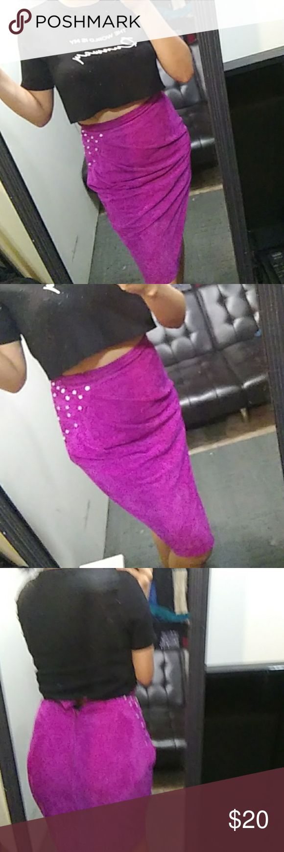 Magenta leather Skirt Magenta leather Skirt with gems on left side of hip,skirt pleated to the right. Very gorgeous high waisted Skirt I'm a a medium and it does fit just didn't button up on me so maybe like a size 6 would be perfect. Genuine leather.open to offers.o n 5th picture does show were it is unraveling the thread. Skirts