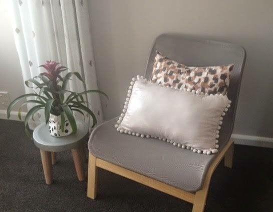 Baby nursery, nursing chair IKEA, envelope cushions, Resene paints, charcoal carpet