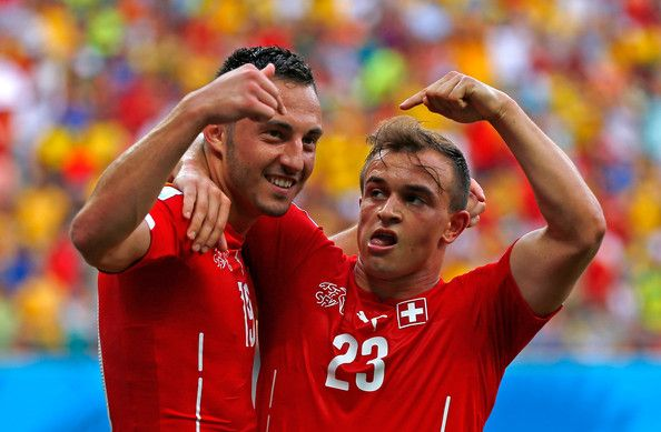 Xherdan Shaqiri (R) celebrates scoring his team's second goal with Josip Drmic of Switzerland during the 2014 FIFA World Cup Brazil Group E match between Honduras and Switzerland at Arena Amazonia on June 25, 2014 in Manaus, Brazil.