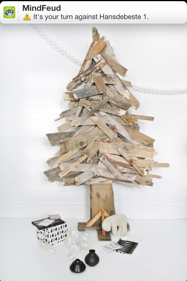 Cool use of scrap wood to create a 2 dimensional pine tree or Christmas tree on the wall...could be used to display tree ornaments...no more pine needles,