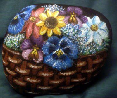 .A pretty little basket full of flowers
