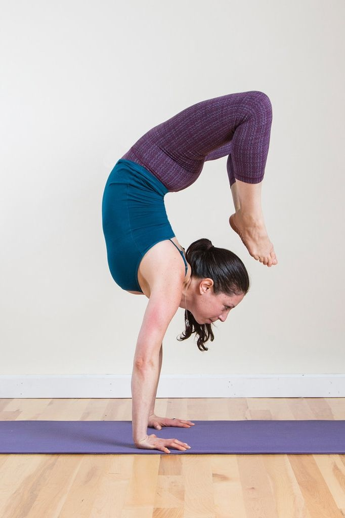 Handstand Scorpion: Just one of the insane yoga poses that most of the population wouldn't dare doing.