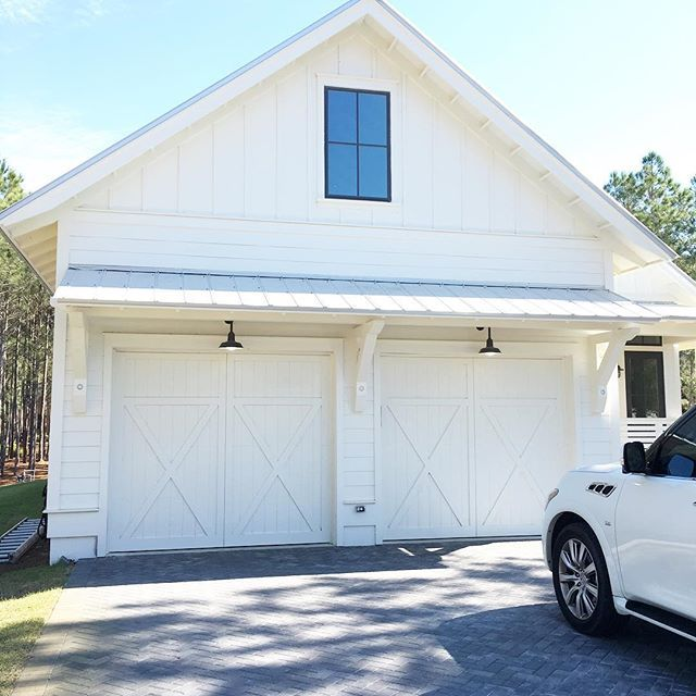 Love our barn lights from @barnlightelectric! {custom carriage style garage doors} #coastal #farmhouse #coastalfarmhouse