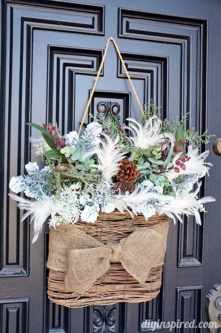 Winter door decor. Add greenery to a basket or other item that can hang on the front door!