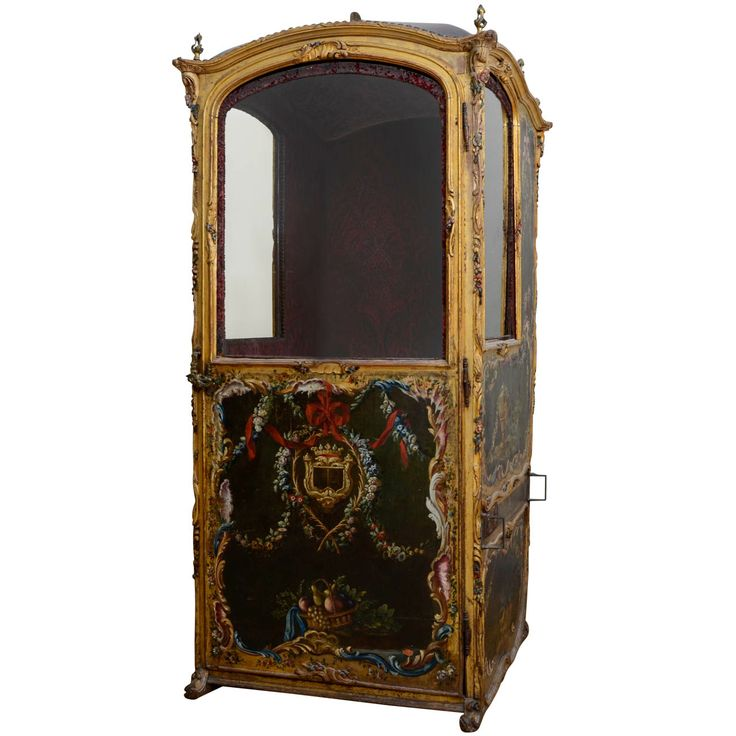 18th Century Gilded Sedan Chair, painted on all faces including the back. Flower scrolls, flower and fruit baskets, knots and ribbons and birds decor. The windows' frame and structure are outlined by a scrolls and flowers bas-relief sculpture. The access door is adorned with a Marquis crown. Bronze door handles and roof adornments.| 1stdibs.com