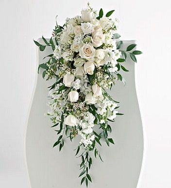 Cascading Flower Bouquets | ... of Wedding Pew Arrangement in white flowers and cream roses.jpg
