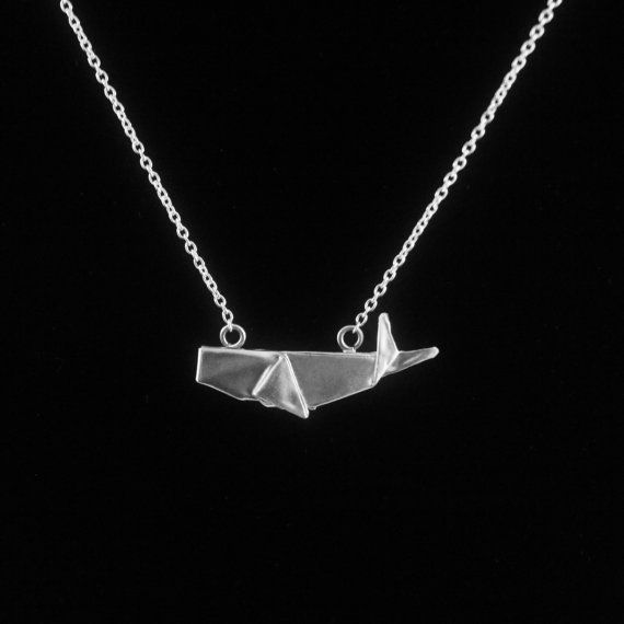 The perfect gift for that whale lover with a love for the one of a kind and handmade.  Each fine silver origami whale pendant measures about 0.9 Inches across and 0.5 Inches in height and is attached to an 16 925 Italian made sterling silver cable chain (pictured). The finish is a satin silver but can also be made in a polished finish if desired (please let us know).  Fine silver whale necklace comes wrapped in a petit giftbox and accented with silk-screened japanese chiyogami paper or…