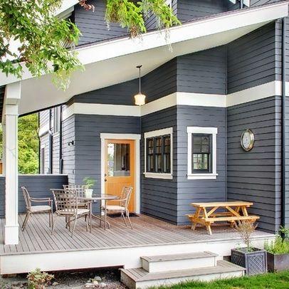 Dark Blue/Gray Exterior With Dark Windows, White Trim, And Orange Door By