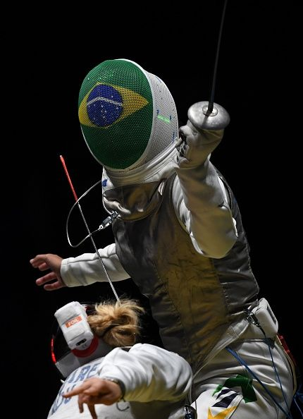 #RIO2016 Brazil's Ana Beatriz Bulcao competes against Romania's Malina Calugareanu during their women's individual foil qualifying bout as part of the fencing...