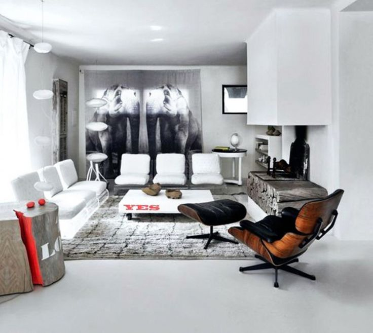 Home: Living Room Remodels With Futuristic Fiberglass White Sofa Wood Liked Fireplace Exclusive Wooden Black Leather Chair And Footstool Grey Fur Rugs Artistic Wood Likes Coffee Table Design Ideas: Extraordinary White Plus Grey House With Cool Art Touches