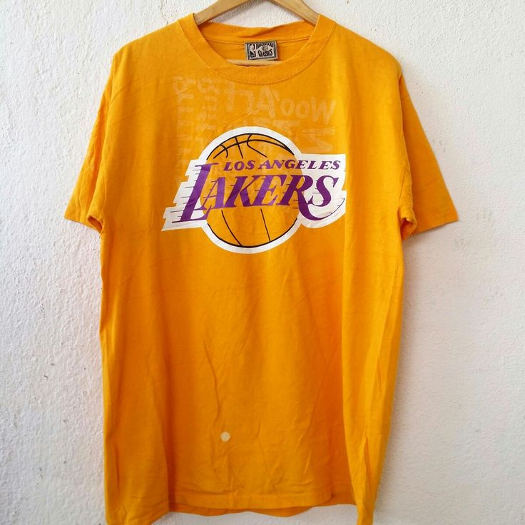 """NBA Hardwood Classic Los Angeles Lakers 32 Johnson Tee Large Shirt Size L VS468  Tag reads: NBA (L) Chest (below armpit to other below armpit): 21.5"""" inches Front length of shirt (top of shoulder to bottom of product): 29.5"""" inches Condition:  Vintage pre owned condition. Commonly slightly faded due to ages and use.   ** WE ARE USING DHL EXPRESS,PLEASE LEAVE YOUR PHONE NUMBER ON THE NOTE  WHILE MAKE A PURCHASE**  If you have any questions, feel free to message me!"""