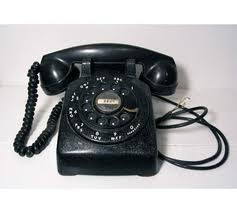 Black Metal Rotary Dial Phone ~ shared a party line with 4 neighbors...listening for a few seconds...getting fussed at for listing...because the party line was shared with relatives!