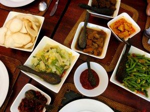 Rijsttafel is a typical dish in the Indonesian Dutch cuisine consisting of rice with many small dishes of spiced vegetables and meats. These dishes are shared among a group of two or more diners, allowing everyone to try a range of items. Are you a fan of traditional Dutch food? Check out our list of 30 Dutch foods to try.