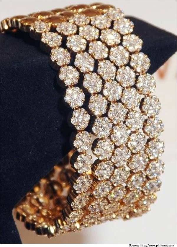 Weighty pieces of jewelry, the diamonds in this kada are arranged in a circular fashion. The sizes of the diamonds are set in floral patterns. - See more at: http://www.metromela.com/diamond-bangles/#sthash.7djLUQCo.dpuf