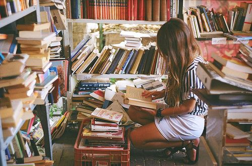 being surrounded by books