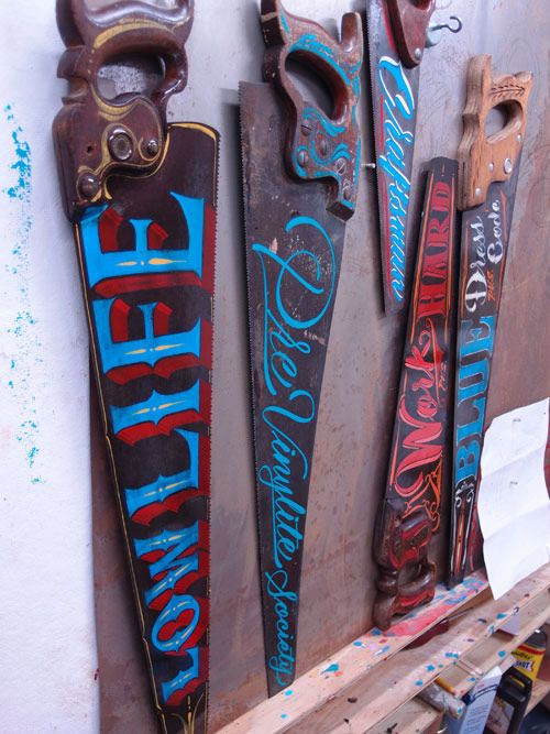 Hand-painted signs on antique saws by Kenji Nakayama