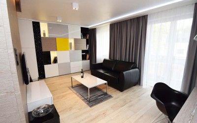#Salon w mieszkaniu pokazowym. Bardzo funkcjonalne #meble do salonu zostały wyprodukowane przez firmę Mobiliani Bydgoszcz.