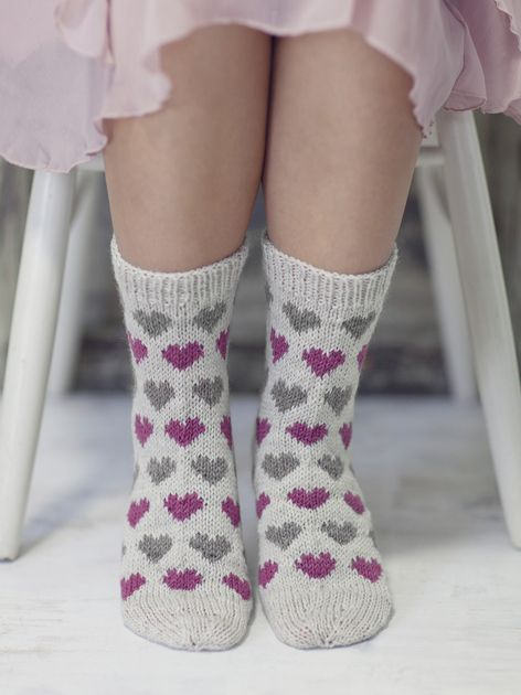 Novita wool socks, Heart socks made with Novita Nalle (Teddy Bear) yarn #novitaknits #knitting #knits #villasukat #raggsockor https://www.novitaknits.com/en