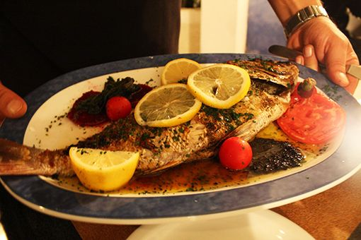 Eat Like a Local in Santorini-Eat at the family run fish tavernas located near the smaller beaches – bonus points if the owners catch their own fish and their Mother is in the kitchen cooking.