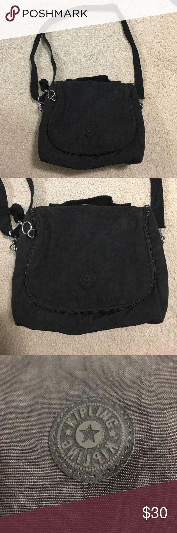 NWOT Kipling Black Shoulder Lunch Bag super cute black lunch bag from kipling. it's unsuliated. only used a couple of times. has an adjustable black shoulder strap and a handle strap on top. Kipling Bags Shoulder Bags
