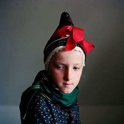 "Europe | Portrait of a young Danish woman wearing traditional clothes and headdress, a strude, ""Strude"", Fanø, Denmark 