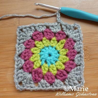 Staring another round of a granny square with the same color yarn
