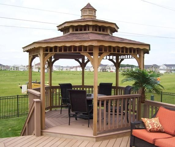 Pressure treated gazebo in Plainfield, IL. This is a kit gazebo that we ordered without railings. We custom built the railings to match the railings on the deck.  Archadeck of Chicagoland
