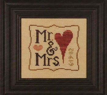 Heart In Hand Needleart Mr & Mrs Wee One - Cross Stitch Pattern. Model stitched on 30 Ct. Parchment linen with Crescent Colours and Gentle Art Sampler threads (