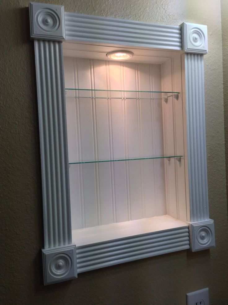 Our medicine cabinet redo. Bead board inset, frame, lighting, and glass shelves. Under $50.