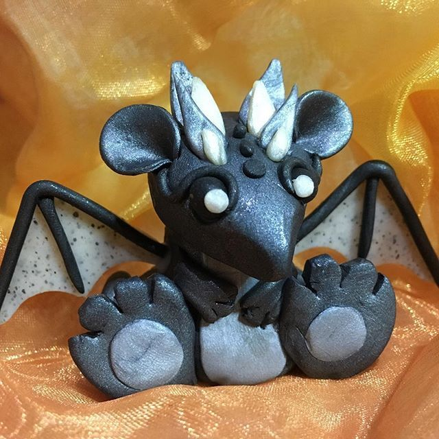 Had fun this afternoon creating this chap! Pretty happy with my first go at making a dragon 😊😊😊 #dragon #dragons #clay #polymerclay #black #silver #wings #cute #handmade #colours #colorfull #first #try #instadaily #instapic #unique #etsy #ooak