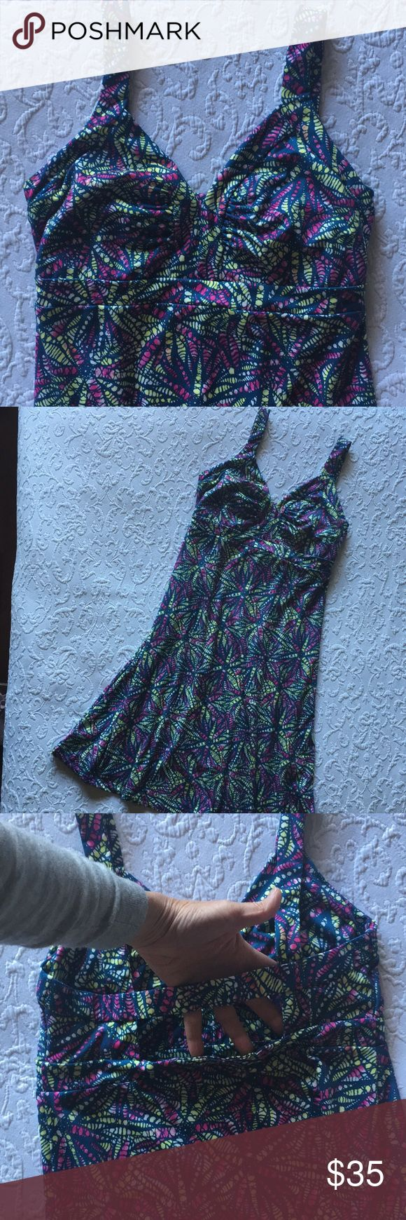 Patagonia dress Beautiful, comfortable and very soft Patagonia dress in like-new condition. Back has cut out above the waist. Fabric along back bra strap is heavily elasticized. Fabric is downy-soft and has a good amount of comfortable stretch. Patagonia Dresses