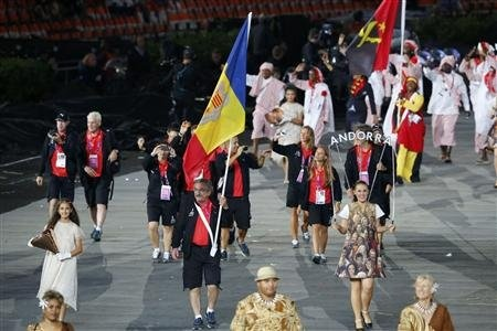 Andorra's flag bearer Joan Tomas Roca holds the national flag as he leads the contingent in the athletes parade during the opening ceremony of the London 2012 Olympic Games at the Olympic Stadium July 27, 2012.