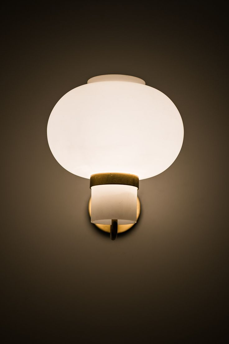 Wall lamps in brass and opaline glass at Studio Schalling