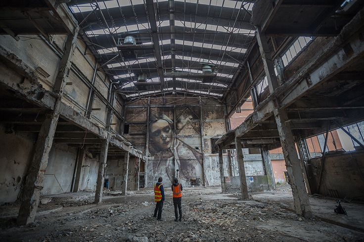 the artist, best known for his large scale portraits of women, realized his latest series of work on the walls of a paper mill's dilapidated machine rooms.