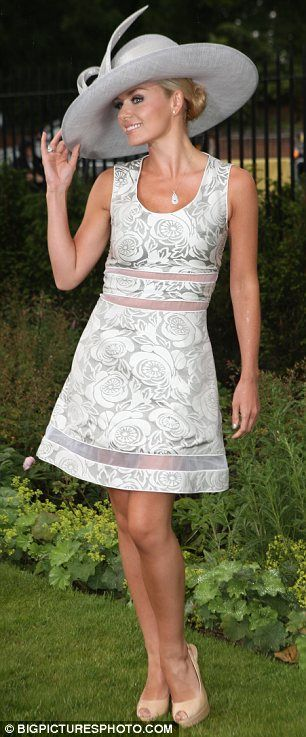Sheer delight: The Welsh song bird looked elegant in her rose print dress which showed off slithers of skin with subtle sheer panels