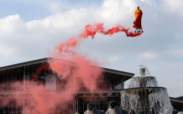 Chinese artist Li Wei performs in the sky over the Fontaine of Lyons at La Villette in Paris. Li Wei's work often depicts him in apparently gravity-defying situations.
