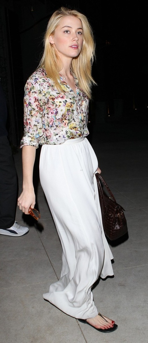 Amber Heard pairs floral chiffon blouse with a plain maxi skirt