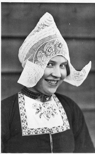A vintage photo of a lady in the Volendam traditional costume. Volendam is in the North Holland region of the Netherlands. From the FolkCostume&Embroidery blog by Roman K.