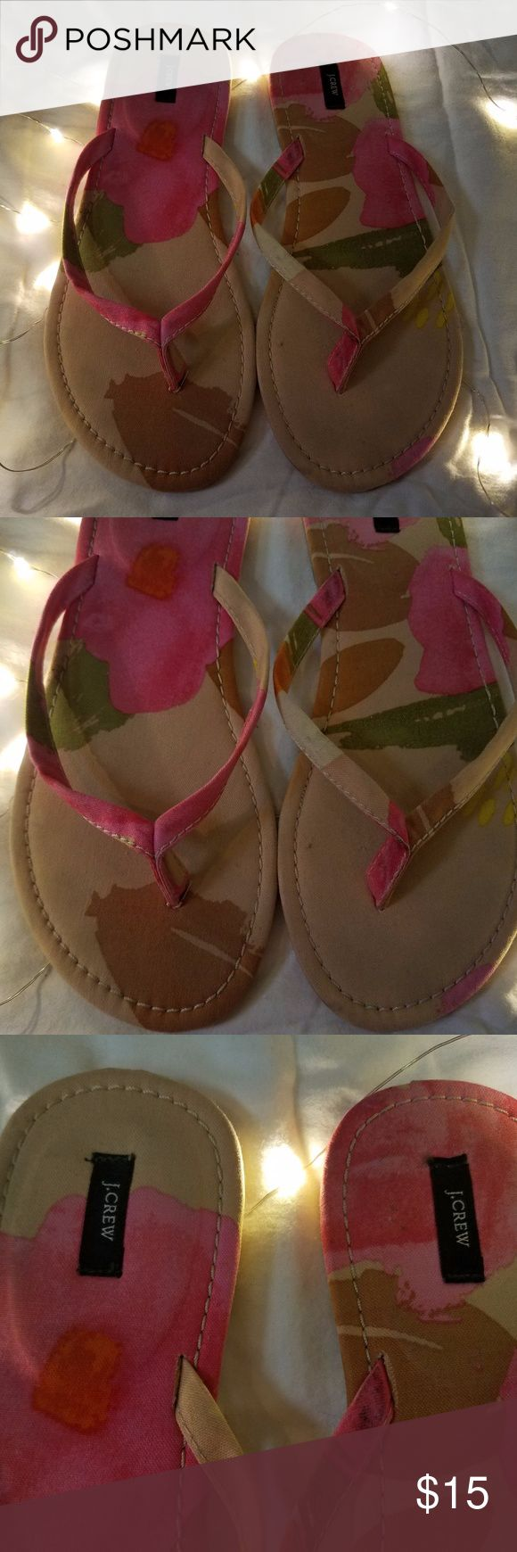 """J.CREW Floral Flip Flops Thong Sandals 0 EUC J.CREW Floral Flip Flops Thong Sandals Women Brown Pink 9 Excellent Used Condition   Beautiful light-weight  flip flops/thong sandals  Materials: Fabric Upper, Rubber Sole  Measurements:  Length: 10"""" in Width: 3.5"""" in  Thank you for looking!  S-S01 J.Crew Shoes Slippers"""