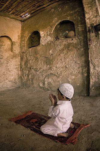 20. A young boy praying.