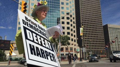 81-year-old voter takes 'Defeat Harper' message to Winnipeg streets #elxn42 #cdnpoli