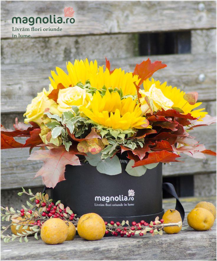 Fall arrangement with sun-flowers, roses and leaves.  Aranjament de toamna cu floarea-soarelui, trandafiri si frunze