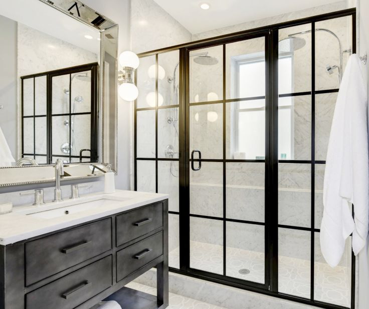 After a long decade of traditional bathtubs the walk-in shower has regain its popularity! This particular walk-in shower, covered in our calacatta marble tile, featuring our new Mystique Collection on the floor and urban style black framed glass doors is the perfect inspiration for your next project! #marblesystems #naturalstone #tiletuesday #bathroom