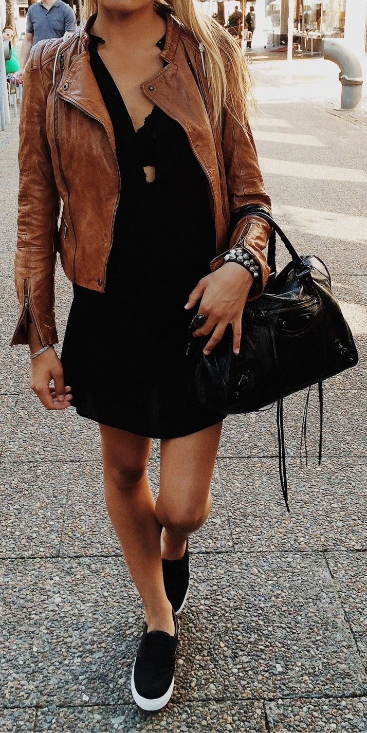 Latest fashion trends: Street style | Black dress, brown leather jacket and flats