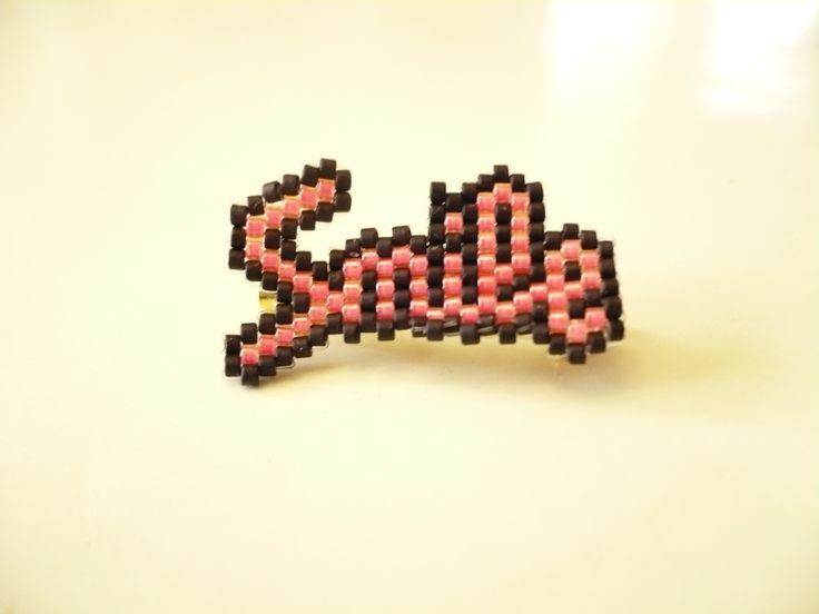 """pink """"smile"""" bead brooch by Regina."""